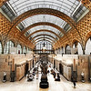 "<h2>The Orsay</h2> <br/>One of my favorite museums!  I'm a huge fan of Impressionism, and this museum has an amazing collection.  It also houses one of the most famous paintings by Manet -  Le dejeuner sur l'herbe (<a rel=""nofollow"" href=""http://en.wikipedia.org/wiki/Le_d%C3%A9jeuner_sur_l'herbe"">Wikipedia</a>).  I've always heard about and studied this painting, so it was of particular interest to me.  When I saw it in person, it was absolutely striking... I did not expect to have a reaction like that.<br/><br/>Well, you aren't supposed to take photos in here, but I just can't help it.  I think the rule is silly and somewhat insulting to he artist in me.  I remember studying the Impressionists...  Manet himself would come into museums and paint...  so what is the difference?  Nothing... I think my Impressionist heroes are looking down on me and smiling for defying such a silly rule.  In this case, I did not use a tripod (would have been a bit obvious).  So I cranked up the ISO on my camera to keep everything sharp.  Also, I set my F stop at 2.8, which keeps a scene like this in focus when you're using a wide angle lens, since everything is effectively at infinity.<br/><br/>- Trey Ratcliff<br/><br/><a href=""http://www.stuckincustoms.com/2011/01/12/100-cameras-in-1-new-version/"" rel=""nofollow"">Click here to read the rest of this post at the Stuck in Customs blog.</a>"