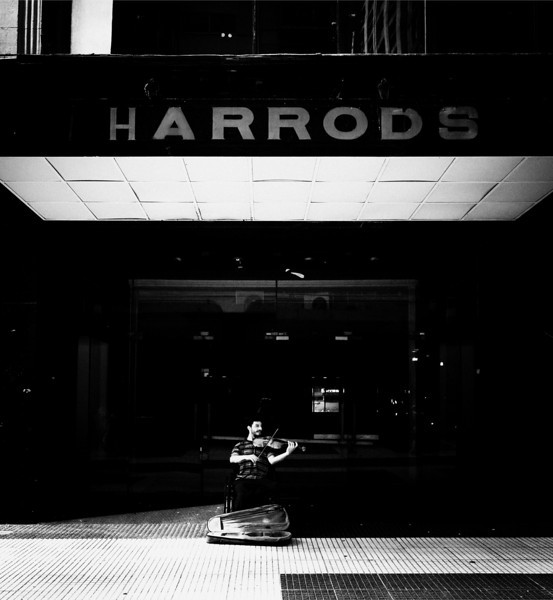 "<h2>The Abandoned Harrods in Buenos Aires</h2> <br/>There are parts of Buenos Aires that are not too safe to walk around by yourself.  This part was not so bad, but there were several abandoned stores around, including this Harrods.  I was surprised to see such a nice store in a state of disrepair, especially after visiting its Valhalla-like anchor in London.  Out front, there was a man playing the violin alone.  It echoed around in a strange way through the acoustics of the tile, the roof, and the lonely streets.  There was a Argentine rhythm he mixed into his playing that really made me feel like I was in a different place.<br/><br/>- Trey Ratcliff<br/><br/><a href=""http://www.stuckincustoms.com/2009/09/19/the-abandoned-harrods-in-buenos-aires/"" rel=""nofollow"">Click here to read the rest of this post at the Stuck in Customs blog.</a>"