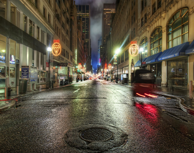 """<h2>The Hover Car in the Diamond Age</h2> <br/>Around the time of the book signing in New York earlier this year, I headed out into the streets for some shooting.  The Diamond District is not too far from Rockefeller Center, and it is a perfect """"New Yorky"""" area at night... especially in the rain.  Between stoplights, I would pop out into the street and grab some frames as quickly as possible.  With five exposures, the last was pretty long at 30 seconds, so it was still a little """"exciting"""" to grab the tripod at the last second and then scurry off the street.<br/><br/>That one car the made it through my tripod-roadblock is interesting, isn't it?  It appears to be a hover-car of sorts.  I can no longer recall what sort of car it was, but I keep staring at that wonderful apparition.  It's quite mesmerizing, floating there on the rainy street.<br/><br/>- Trey Ratcliff<br/><br/><a href=""""http://www.stuckincustoms.com/2010/08/10/the-hover-car-in-the-diamond-age/"""" rel=""""nofollow"""">Click here to read the rest of this post at the Stuck in Customs blog.</a>"""