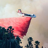 John Chaides / Courier<br /> California Department of Forestry and Fire air tanker drops fire retardant over Linda Flora Drive during the Skirball Fire on Wednesday, December 6, 2017.