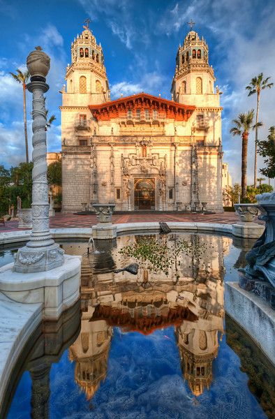 """<h2>Hearst Castle in San Simeon</h2> <br/>Did you know that Hearst Castle is only a few hours north of LA?  If you ever end up in LA for a trip, be sure to set aside a few hours for a trip up to see this place.  After you get out of the LA city-scape-area, the terrain totally changes - so does the """"feeling"""".<br/><br/>Towards the end of the day, all the tourists had left.  I had an escort with me for most of the day.  This gentleman was a retired LAPD officer who spends a few days per week working up at Hearst Castle.  There are several of these guys and gals that help keep the place secure.  They take the job pretty seriously, as you would expect from any LAPD-type.  After a few hours, I was able to wear them down with humor.  I found they responded very well to anti-lawyer humor, btw.  So keep that one in mind in case you ever get in a pinch.<br/><br/>Everyone there was extremely nice, and I loved the opportunity to capture Hearst as it is meant to be captured.  I kept returning to this fountain time and time again -- until the skies and light was just right...<br/><br/>- Trey Ratcliff<br/><br/><a href=""""http://www.stuckincustoms.com/2010/05/14/hearst-castle-in-san-simeon/"""" rel=""""nofollow"""">Click here to read the rest of this post at the Stuck in Customs blog.</a>"""
