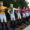 Jockey Statues Displaying the Colors of the Winning Horses