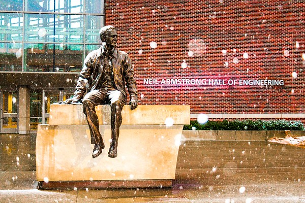 Snow falling around the statue of Neil Armstrong at Purdue University