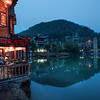 "<h2>Night Settles In Feung Huang</h2> There is a general poetic peace when it begins to go dark outside and the town comes alight with shopkeepers and villagers come out to turn on the lights.  If you look around, you can see them popping on, one at a time, like little fireflies coming out to play for the evening.  This area is no different, and it's made even more magical by the little river that flows through the middle of it all.  And then you are faced with all these nice decisions... where to eat?  where to drink?  where to find an inn for the night?    - Trey Ratcliff  Read more <a href=""http://www.stuckincustoms.com/2011/06/30/night-settles-in-feung-huang/"">here</a> at the Stuck in Customs blog."