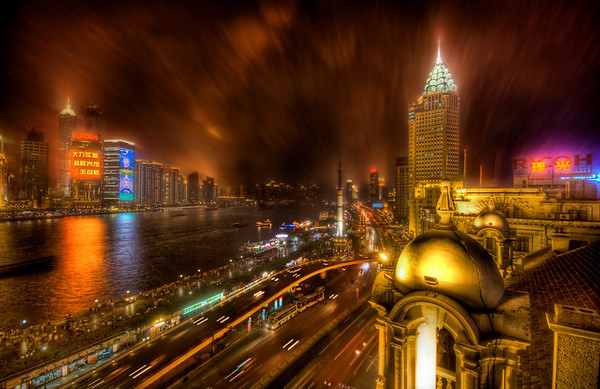 The Bund in the Rain This is shot from the old British part of Shanghai called the Bund. The rain was bitter rough that night and I was on the roof, but I managed to get in position and stay dry enough (for a moment) for this one.- Trey RatcliffClick here to read the rest of this post at the Stuck in Customs blog.