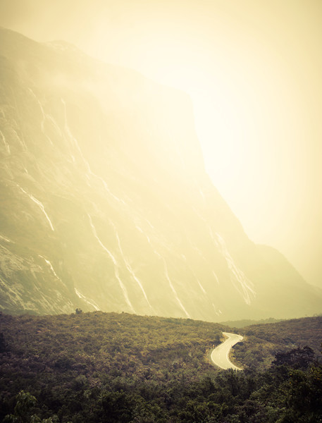"<h2>The Foggy Road Through The Waterfalls to Milford</h2> <br/>There is a long tunnel through a mountain upon final approach to Milford Sound. The tunnel itself is unnerving because it is downhill. I'm not used to long tunnels going downhill. Anyway, after you get out, something new always awaits you. I've been through the tunnel 10 times now. 3 times there were clouds, and this was one of them. The good news is that the clouds mean rain, and the rain means waterfalls!<br/><br/>- Trey Ratcliff<br/><br/><a href=""http://www.stuckincustoms.com/2013/01/29/the-foggy-road-through-the-waterfalls-to-milford/"" rel=""nofollow"">Click here to read the rest of this post at the Stuck in Customs blog.</a>"