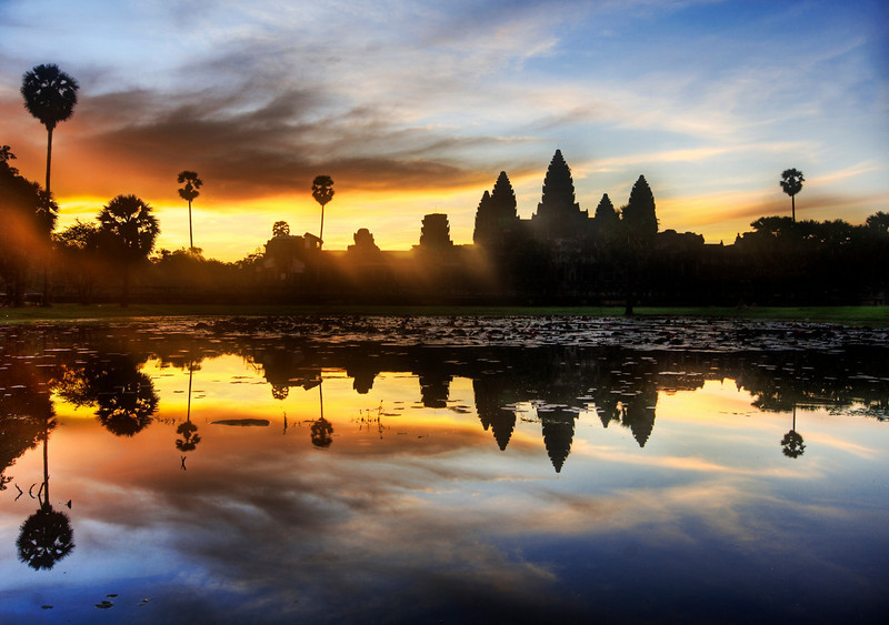 "<h2>Sunrise Discovery of Angkor Wat</h2> <br/>I feel a bit like a British explorer, surrounded by my cadre of Cambodians at $18 a day.  They drive me around, carry my tripod, bring me water when I am thirsty, and seem anxious for me to colonize the area.  A member of my cadre woke me up early this morning at 5 AM.<br/><br/>- Trey Ratcliff<br/><br/><a href=""http://www.stuckincustoms.com/2007/06/02/sunrise-discovery-of-angkor-wat/"" rel=""nofollow"">Click here to read the rest of this post at the Stuck in Customs blog.</a>"