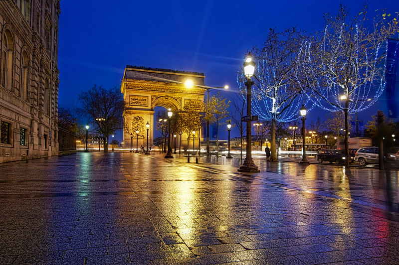 """<h2>Le Arc de Triumph from the Champs-Élysées</h2> <br/>This wonderful landmark is always fun, but challenging, to photograph.  It's right in the middle of a roundabout that is as dangerous as that thing Bond got stuck in to test G-forces in Moonraker.  There was a recent rain, and the Champs-Élysées was shiny and perfect in the cool dusk air.  I set up and kept the f stop as high as possible so that the French passerby would fall out of the frame during the long exposure.<br/><br/>- Trey Ratcliff<br/><br/><a href=""""http://www.stuckincustoms.com/2009/06/21/le-arc-de-triumph-from-the-champs-de-elysses/"""" rel=""""nofollow"""">Click here to read the rest of this post at the Stuck in Customs blog.</a>"""