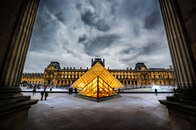 The Glowing Louvre Here's another photo from the amazing PhotoWalk in Paris. This was supposed to be the end of the walk, but it ended up being the halfway point!In post-processing this one, I made the Louvre feel a little more warm and inviting, while the outside stayed a bit more cold and foreboding. I edited this one in front of a live class in Christchuch… I hope people enjoyed that bit ! :) Not all of my edits were successful that day, but I think this one turned out alright.- Trey RatcliffClick here to read the rest of this post at the Stuck in Customs blog.