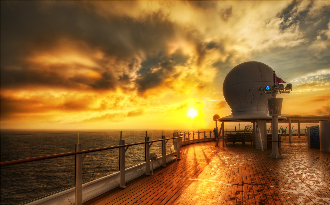 Morning on the Wet Decks On the Disney Cruise, I made it up for sunrise about 4/7 mornings. That's not so bad. My goal was to do 7/7 mornings, but I'm only human.The room was always cool and dry, and the outdoors was warm and wet. My lenses needed more time to wake up than me. That foggy-covering lasted a good 10 minutes, and then I gave it a bonus 5 minutes because there is a very slow final ramp-down of the moisture upon the glass. I heard that if you keep your camera in a ziplock bag then take it out that the moisture will form there instead of on the lens. I don't know if I believe it, but I will try it next time.- Trey RatcliffClick here to read the rest of this post at the Stuck in Customs blog.