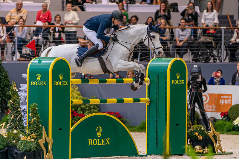 Martin Fuchs on Clooney 51 over the last jump of the Rolex Grand Prix at CHI GENEva 2019