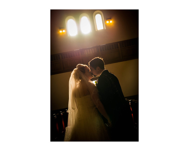 Wedding Photography of Nia & Robert, Wellesley Parish Church, Fife, Scotland, Photograph is of the Bride & Groom in the church aisle with the sun shinning in through the window onto them