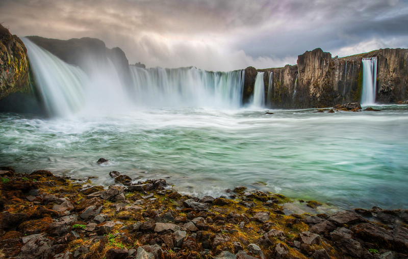"""<h2>Waterfall of Certain Doom</h2><br/>This has become one of my favorite remote waterfalls in the world! Whenever I am taking photos of these places, I spend a lot of time there. I often imagine what it would be like to tumble over the edge… wondering various ways I could survive… if I'd get caught in a whirlpool underwater… or if I would just pop up like in the movies.<br/><br/>If you are ever near Akureyri, I suggest you visit this spot… if you are feeling bold, clamber down the side of the waterfall like I did here to get this shot…<br/><br/>- Trey Ratcliff<br/><br/><a href=""""http://www.stuckincustoms.com/2012/06/16/waterfall-of-certain-doom/"""" rel=""""nofollow"""">Click here to read the entire post, including an announcement of a new eBook at, at the Stuck in Customs blog.</a>"""