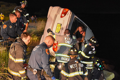 An off-duty NYPD officer allegedly intoxicated crashes her vehicle with her son and dog inside, nearly plunging into the bay just west of Sore Thumb Beach in West Islip. 08-08-2017