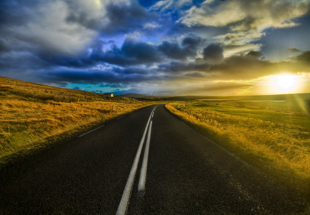 """<h2>The Open Road</h2> <br/>I had a long lonely weekend in Iceland, so I took my rental Jeep out into the wild. I drove all over the country from dawn till dusk seeing what I could find. The sky and landscape was an ever changing palette of colors and clouds.<br/><br/>The sun is so low on the horizon during the winter that it is almost like a 5-hour sunrise followed by a 5-hour sunset. I drove up and down one of these highways to the next, listening to all kinds of strange and eclectic music on my iPod, occasionally jumping out to take a shot of something like this... it was a perfect weekend.<br/><br/>In the distance, you can see the snowy mountains which always seem to be just a few songs away.<br><br>- Trey Ratcliff<br/><br/><a href=""""http://www.stuckincustoms.com/2007/11/19/the-open-road/"""" rel=""""nofollow"""">Click here to read the rest of this post at the Stuck in Customs blog.</a>"""