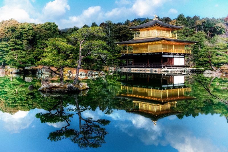 "<h1>Temple of the Golden Pavilion</h1>  <p>A Zen Buddhist Temple with a Golden Pavilion surrounded by a small lake. The pavilion is coated in Gold Leaf.</p>  <p>Read more about the <a href=""http://alikgriffin.com/blog/jul/12/temple-golden-pavilion-kyoto-japan"">Temple of the Golden Pavilion at AlikGriffin.com</a></p>"