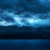 "<h2>Mountainstorm</h2> <br/>I took an evening drive to Glenorchy, which is about 50 km outside of Queenstown.  It's one of the windiest drives in the world, especially in the middle of a violent storm!  The rain stopped for a short time while I went on a short hike to capture the mountains across the lake.  The wind was so intense.  After setting up the tripod and setting up the interval timer, I had to shield the whole thing with my body, by leaning <em>into</em> the wind on the more threatening side of the camera.  As I was doing this, I was wondering if anyone would <em>really</em> want to be my assistant.  it's not nearly as glamorous as you might think!<br/><br/>- Trey Ratcliff<br/><br/><a href=""http://www.stuckincustoms.com/2010/03/09/the-remarkables-queenstown/"" rel=""nofollow"">Click here to read the rest of this post at the Stuck in Customs blog.</a>"