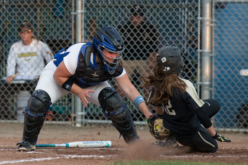 Southington's catcher Maighread Scafariello tags out Trumbull's Maggie Coffin at home protecting the lead Saturday during the Class LL softball finals at West Haven High School in West Haven Jun. 10, 2017 | Justin Weekes / For the Record-Journal