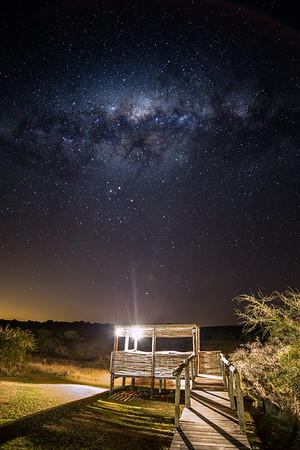 The Milky Way over a game viewing platform at Hlosi Lodge in Amakhala Game reserve, Eastern Cape