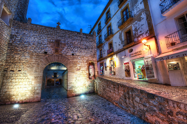 Spanish Streets at NightThe old part of Ibiza is has a medieval layout where the inner city is ringed by a city curtain wall. Once inside, all the streets are narrow and twisty and lined with different kinds of stone. This looks back at the main entrance to the area.I haven't spent as much time in some of these ancient old cities as I would like. There is a lot of satisfaction in setting up for shots in these areas. It's nice to take my time and compose this and that… I find great enjoyment in this!- Trey RatcliffClick here to read the entire post at the Stuck in Customs blog.