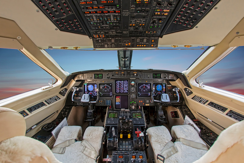 Plush trim cockpit with wide centered showcase of control panels and panoramic view of twilight sky in airspace. This single picture was edited multiple times to create various effects. This method of photography enables us to minimize shooting/photography time to help keep your planes in the air.