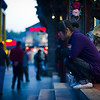 "<h2>Shopkeeper in Beijing on Steps</h2> I carry around two cameras so I can get things like this.  I keep my main body affixed to my tripod with whatever lens fits the bill.  This is either a the 14-24 or the 28-300.  I keep my second camera with a prime -- either the 50 or 85 prime.  I was taking photos of the festive street at dusk, and I noticed this shopkeeper out taking a rest.  I've always admired how people can rest in this position.  I can only sit in that position for about 15 seconds before I scream in agony and my patellas pop off at a hyperspeed tangent.  - Trey Ratcliff  Read more <a href=""http://www.stuckincustoms.com/2011/06/22/shopkeeper-in-beijing-on-steps/"">here</a> at the Stuck in Customs blog."