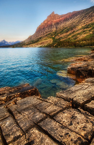 "<h2>The Frozen Granite</h2> <br/>Getting to this spot in Glacier National Park wasn't easy.  It was even tougher trying to get Ethan and Tina into the exact spot too.  Even though this area had all this cool granite around it, there was a bit of a swamp there that we had to traverse first.  And, just around the corner was a nice sandy beach!<br/><br/>- Trey Ratcliff<br/><br/><a href=""http://www.stuckincustoms.com/2009/11/27/the-frozen-granite/"" rel=""nofollow"">Click here to read the rest of this post at the Stuck in Customs blog.</a>"