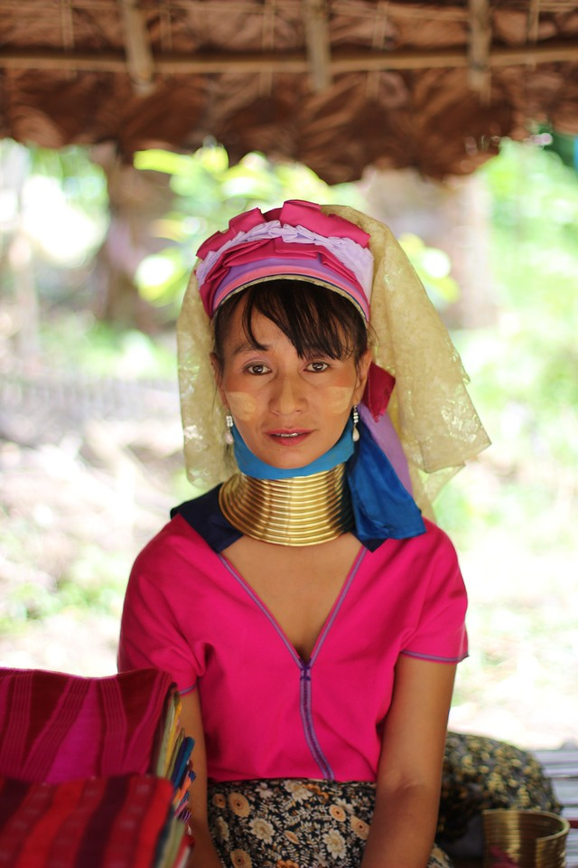 Longneck Hilltribe Woman in Chiang Mai Thailand. You don't have to travel to far outside of the city of Chiang Mai to find Longnecks, sadly this woman was only in costume to try and sell her handicrafts at a market.