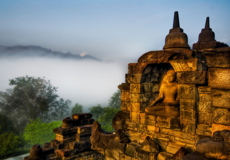 "<h2>Buddha in the Jungle Highlands</h2> <br/>This peaceful buddha looks out across the mist and fog on a relaxing morning…<br/><br/>- Trey Ratcliff<br/><br/><a href=""http://www.stuckincustoms.com/2008/04/15/buddha-in-the-jungle-highlands/"" rel=""nofollow"">Click here to read the rest of this post at the Stuck in Customs blog.</a>"