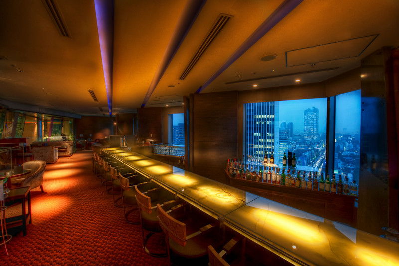 """<h2>A Bar with a View</h2> <br/>This is an incredible bar in that overlooks the amazing city of Tokyo.  The place was amazingly awesome, and I could see it becoming a major hangout if I lived in the city.  Then again, everywhere I went I could picture as a major hangout!  Can anyone figure out exactly where this was taken?  These little photo mysteries don't last long around here!<br/><br/>- Trey Ratcliff<br/><br/><a href=""""http://www.stuckincustoms.com/2009/11/24/a-bar-with-a-view-and-time-running-out-to-get-limited-edition-print/"""" rel=""""nofollow"""">Click here to read the rest of this post at the Stuck in Customs blog.</a>"""