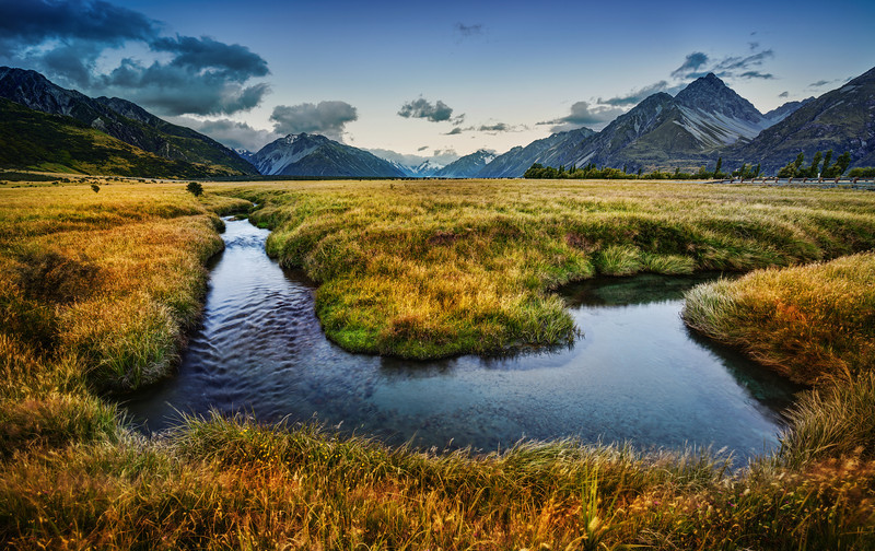 """<h2>The Valley of Mount Cook</h2> <br/>One of the most unexplored (but easy to explore!) areas of Mount Cook is the valley. After you pass the lake, the valley opens up into a tremendous plain. There are thousands of little bits here and there to find. This is one of many gentle streams that flows across the valley floor. I walked along this one for a few kms… getting interesting shots throughout. Plus, no one is around… so, once again, you are off on your own!<br/><br/>- Trey Ratcliff<br/><br/><a href=""""http://www.stuckincustoms.com/2013/03/07/the-valley-of-mount-cook/"""" rel=""""nofollow"""">Click here to read the rest of this post at the Stuck in Customs blog.</a>"""