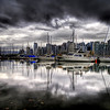 "<h2>The Rainy Season of Vancouver</h2> <br/>Vancouver was experiencing a major storm system.  It made it rather tough to take pictures, but I did get a few in that I will post in coming weeks.  This shot is across the harbor, looking back at downtown Vancouver.<br/><br/>- Trey Ratcliff<br/><br/><a href=""http://www.stuckincustoms.com/2006/11/07/most-rain-ever/"" rel=""nofollow"">Click here to read the rest of this post at the Stuck in Customs blog.</a>"