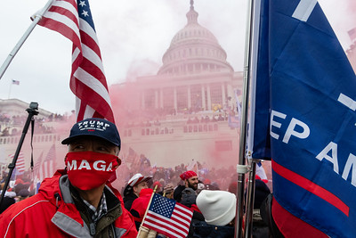 A protester unleashes a smoke grenade in front of the Capitol Building in Washington, D.C., U.S., on Wednesday, Jan. 6, 2021. Photographer: Eric Lee/Bloomberg