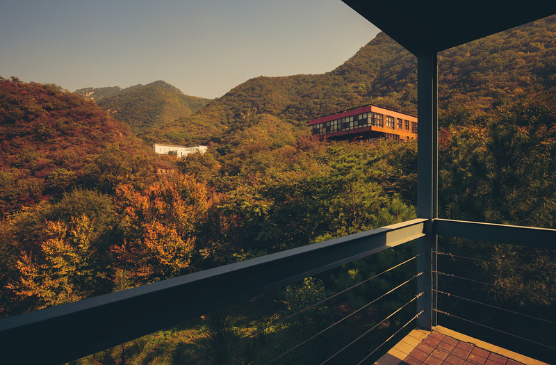 """<h2>The Commune, China</h2> <br/>This is a really cool place near Beijing!<br/><br/>It's an expensive resort, but really quite unique. They had a series of architects come in and create very modern """"houses"""" that are scattered across the hilly countryside. Then, they """"repeated"""" those designs and created many little """"rooms"""" inside each of the houses where you can stay. One of the other great features of the resort is that you can begin a walk up an old river bed for about half a mile before reaching a forgotten, abandoned part of the Great Wall of China.<br/><br/>- Trey Ratcliff<br/><br/><a href=""""http://www.stuckincustoms.com/2013/01/08/the-commune-china/"""" rel=""""nofollow"""">Click here to read the rest of this post at the Stuck in Customs blog.</a>"""