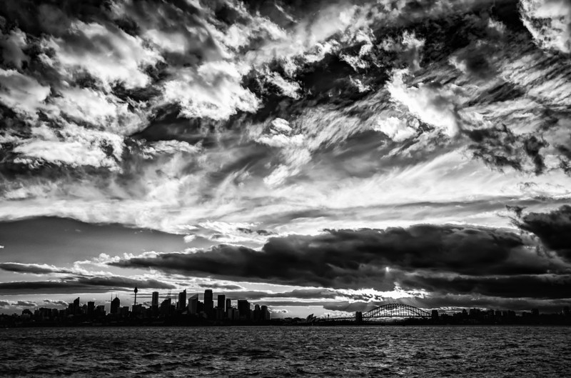 Sydney Harbour Under Mountains of Clouds This might have been the last shot I took with my Nikon D800 before the wind blew it over to destroy it. It turned out that I could not repair it, so I had to buy another D800. Sad Trey. I hope the shot was worth it… many Bothans died to bring you this photo… :)- Trey RatcliffClick here to read the rest of this post at the Stuck in Customs blog.