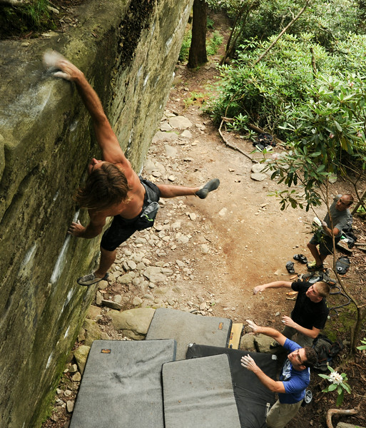 Christian Drum sticks the second dyno at the Long Wall Boulder on Grandmother Mountain.