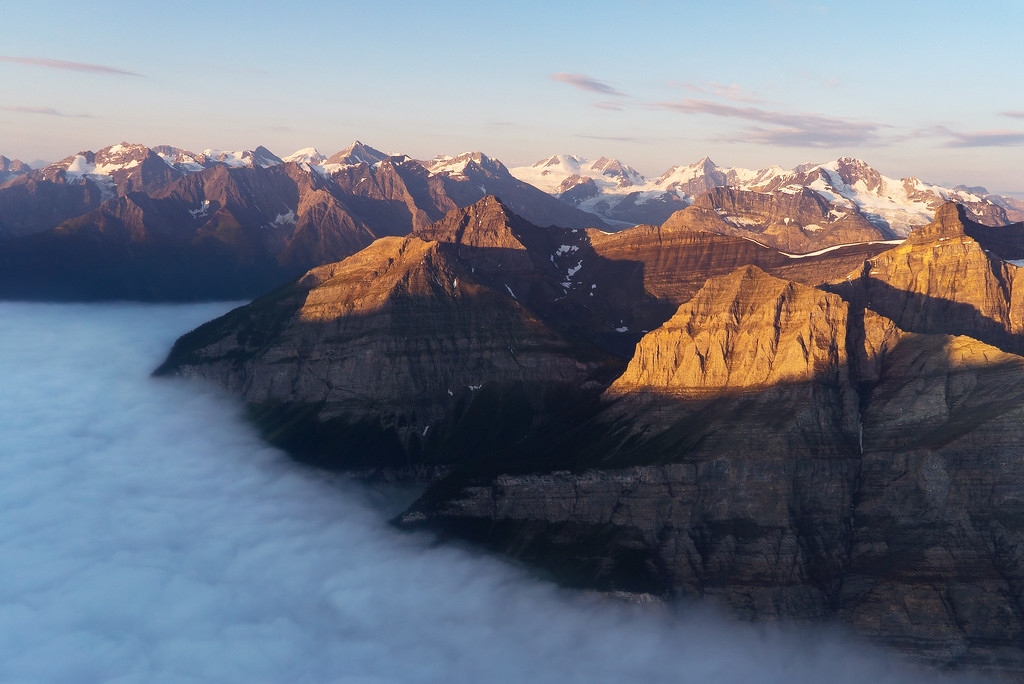 Foggy Sunrise Helicopter Flight over Banff National Park