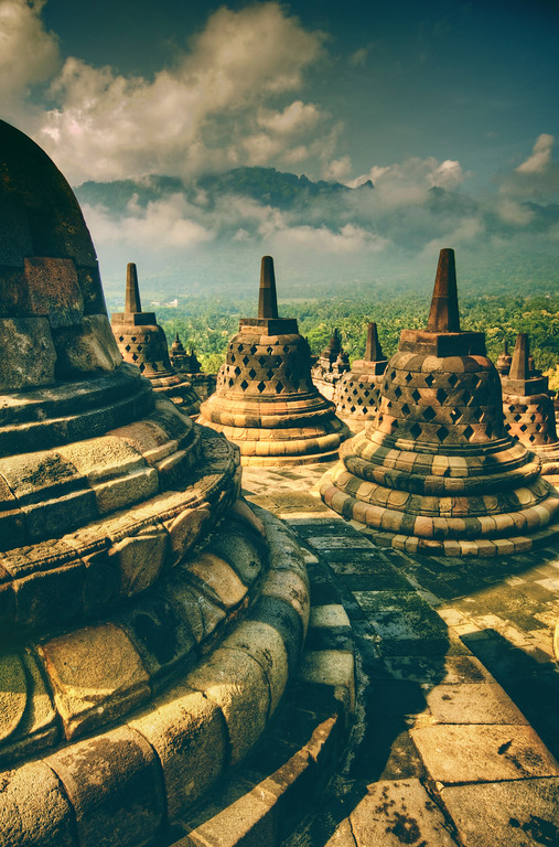 """Old Jogjakarta I visited this area of Jogjakarta day after day to get different light and different conditions. This is the old temple of Borobudur, and each of these """"bells"""" is a stupa-cage that protects stone buddhas that sit inside.I wanted to get a photo of the inside, but it's extremely difficult… so you'll just have to take my word for it! :)- Trey RatcliffClick here to read the rest of this post at the Stuck in Customs blog."""