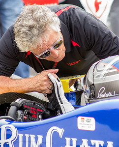 Mario Andretti leans in to give grandson Marco Andretti a few last minute words of encouragement before Marco heads out onto the infamous Indianapolis Motor Speedway oval to make his Indianapolis 500 Pole Day qualifying attempt - May 17, 2015. © Jason Porter Media