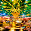 "<h2>A Carousel in France</h2> <br/>It was just past 10 PM on the wet streets of Paris as I was getting lost on purpose around the streets near the Church of the Sacred Heart.  I bobbed and weaved through various little alleys, streets, and tiny bakeries (where I would just have to stop for a moment), before finding my way to this little faire.  There was a small carousel spinning away with tiny little French children screaming wonderful things...<br/><br/>- Trey Ratcliff<br/><br/><a href=""http://www.stuckincustoms.com/2008/07/31/a-small-carousel-in-a-france/"" rel=""nofollow"">Click here to read the rest of this post at the Stuck in Customs blog.</a>"