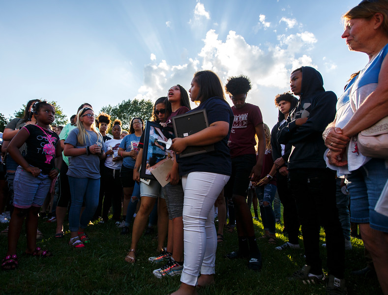 Nadav Soroker/Times-Georgian<br /> <br /> Teonna Thomasson, center, with Ansley Thomasson and Tierra Thomasson thanks all the friends and family who came out for a candle lighting ceremony in memory of Devon Thomasson, filling Knox Park, on Monday, May 20, 2019. Devon, 14, died in a car crash on May 18, 2019.