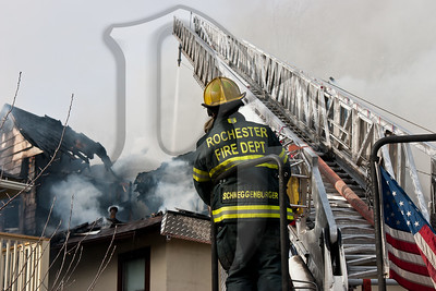 A Rochester firefighter operates at the scene of a 2nd alarm structure fire on Dartmouth St. in the city. This house operated as a Bed & Breakfast called the Dartmouth House.