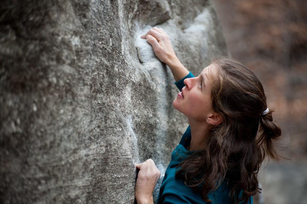 Leah Webb climbs at Rumbling Bald Boulders near Asheville, North Carolina.