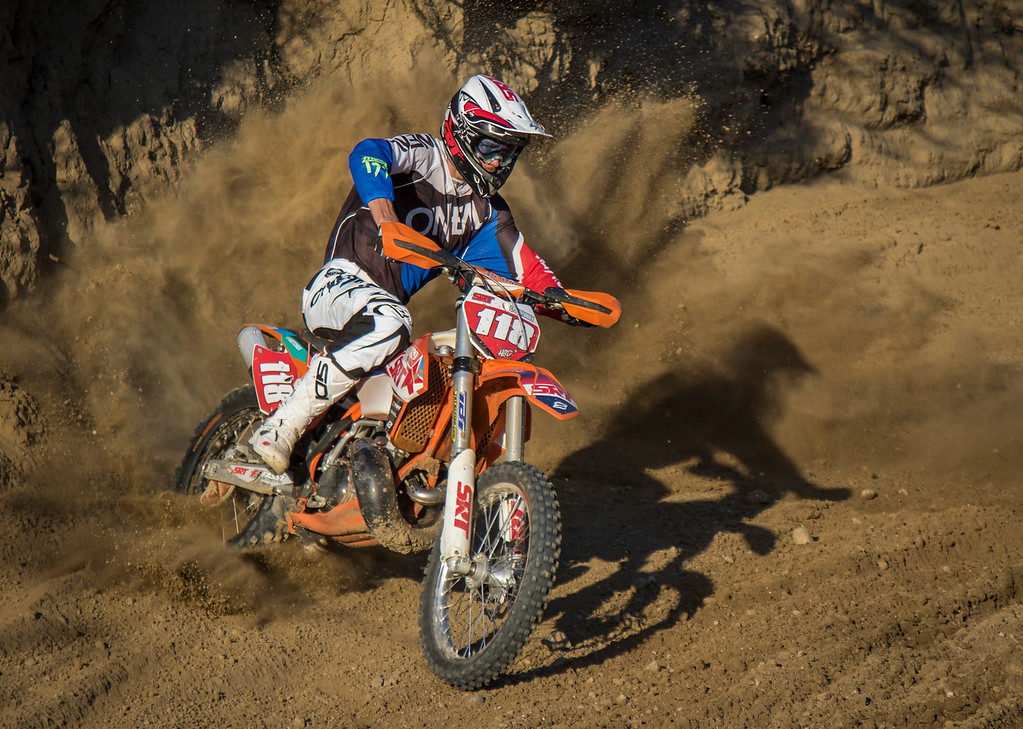 On the Wednesday afternoon of Oct. 21, 2015, professional Moto X rider Cory Graffunder is twisting the throttle hard and blasting out of a turn at Piru Motocross Park in Piru, Calif. (© Erica Jacques 2016)