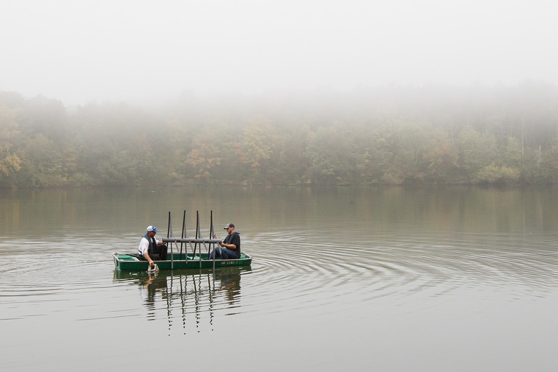Ron Frisk left and Travis Frisk both of Berlin get ready to set a fish attracter  Sunday at Crescent Lake in Southington September,21 2014 | Justin Weekes / For the Record-Journal