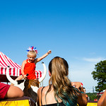 Nadav Soroker/Times-Georgian<br /> <br /> Adrianna Clark, 6, rides the mechanical bull while other kids watch at the 13th annual Villa Rica Fireworks Extravaganza at the V-Plex Sports Complex, Tuesday, on July 3, 2018.