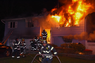 Central Islip firefighters work quickly in an attempt to control a fast moving fire in a residence with people trapped inside. 04-30-2017