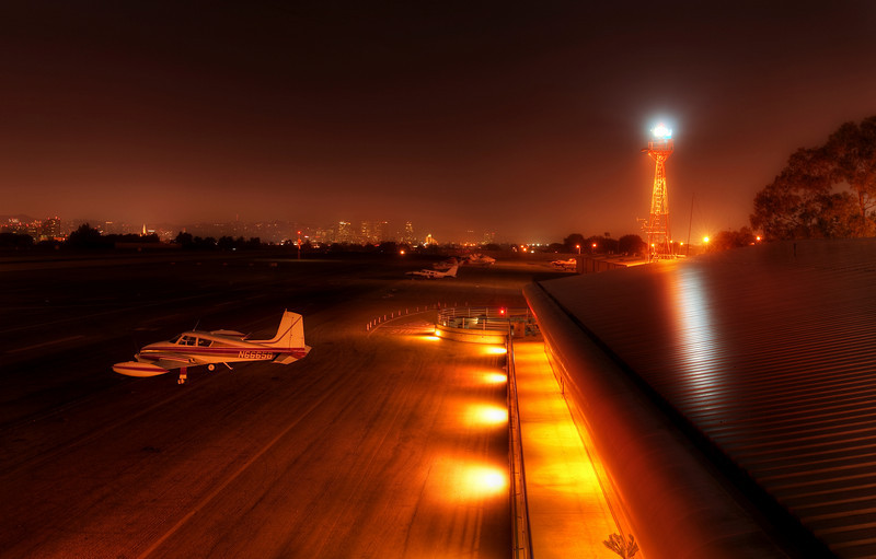 "<h2>One Plane Alone at the End of the Night</h2> <br/>Here we are at Santa Monica Airport deep in the night.  It was quiet.  And peaceful. <br/><br/>I spend a massive amount of time at airports.  I'm usually totally alone, and, most of the time, this is perfectly all right.  I've developed an ever-changing internal dialog that keeps me mentally stimulated at all times.  I'm glad no one can read my thoughts... surely they would find the cacophonous chorus to be the height of lunacy.  And then, when things finally bubble over, well, it is nice to have a kindred spirit around.<br/><br/>- Trey Ratcliff<br/><br/><a href=""http://www.stuckincustoms.com/2010/04/01/one-plane-alone-at-the-end-of-the-night/"" rel=""nofollow"">Click here to read the rest of this post at the Stuck in Customs blog.</a>"