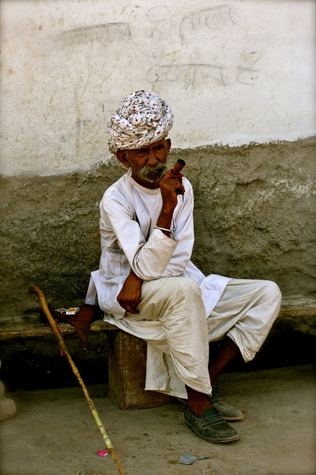 A big cigar, and a bigger turban. Taken in Rajasthan India.