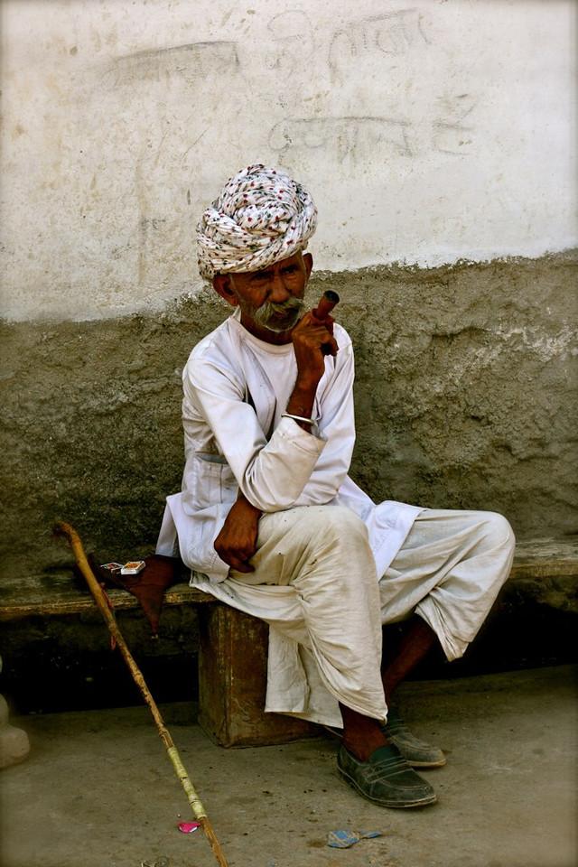 A big cigar, and a bigger turban. Taken in Rajasthan India.